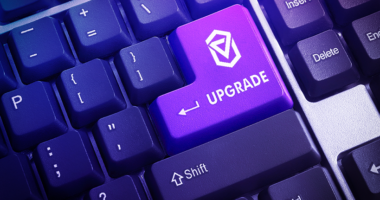 "A keyboard key marked with the ""Upgrade"" word."